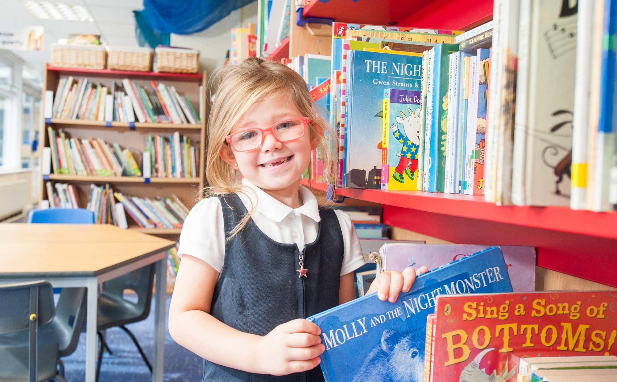 Pupil in the library at St Philip's CE Primary School