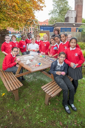 Pupils learning outside at St Philip's CE Primary School