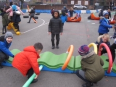 Children making a noodle tunnel
