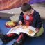 Pupil reading on World Book Day
