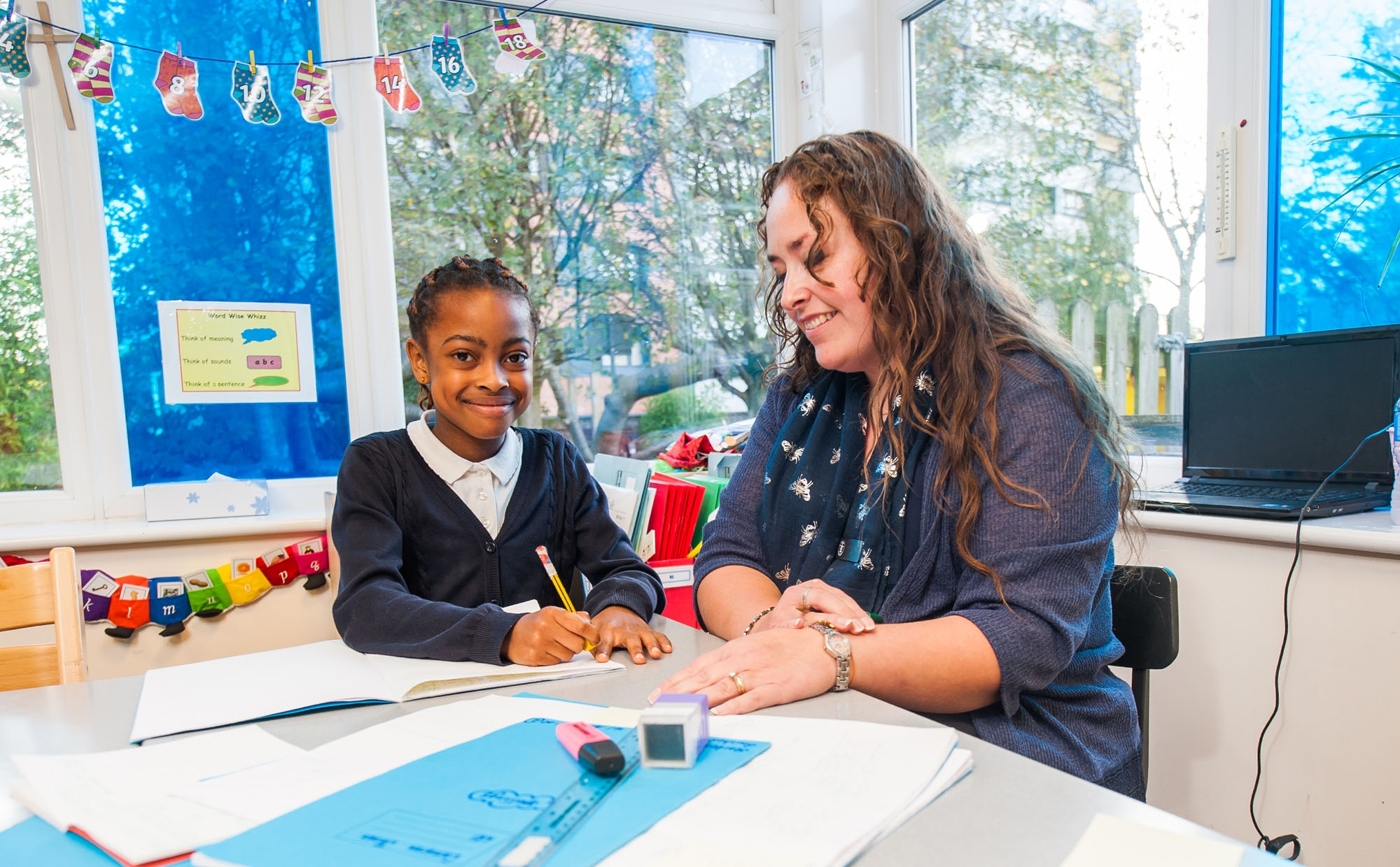 Pupil and teacher at St Philip's CE Primary School