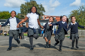 Pupils playing outside at St Philip's CE Primary School