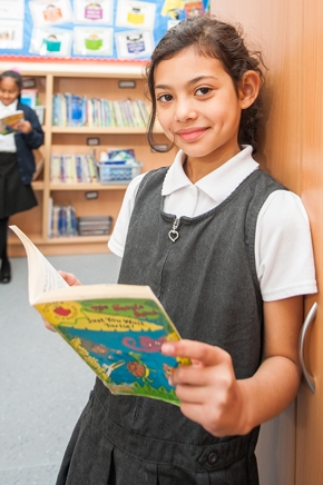 Pupil reading at St Philip's CE Primary School