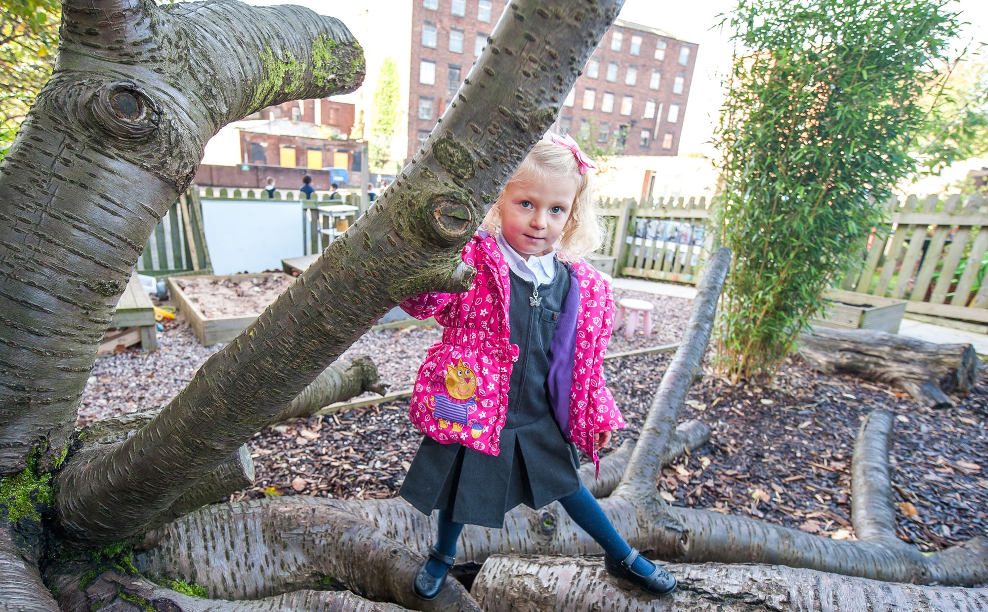 Pupil playing outside at St Philip's CE Primary School